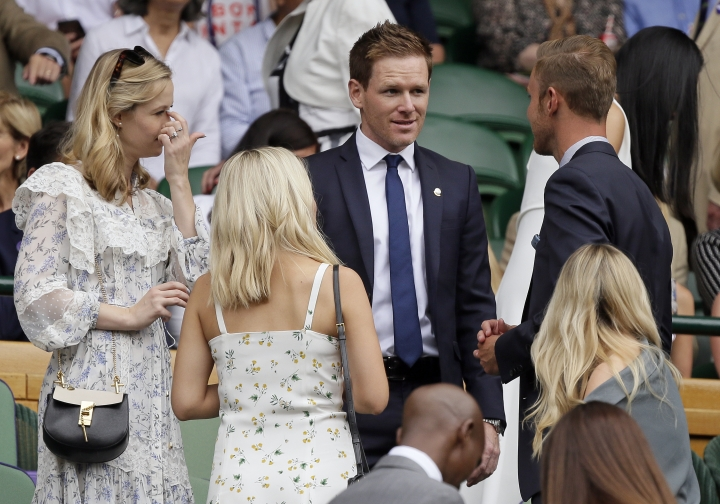 England one day cricket team captain Eoin Morgan arrives to take his seat in the Royal Box on Centre Court during day six of the Wimbledon Tennis Championships in London, Saturday, July 6, 2019. (AP Photo/Tim Ireland)