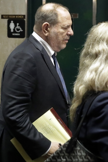 "Former movie mogul Harvey Weinstein, carrying a pad with a Tic-Tac-Toe game, leaves State Supreme Court following a hearing related to his sexual assault case, Thursday, July 11, 2019, in New York. Weinstein's lawyer Jose Baez went to court Thursday to get a judge's permission to leave the case, the latest defection from what was once seen as a modern version of O.J. Simpson's ""dream team"" of attorneys. (AP Photo/Richard Drew)"