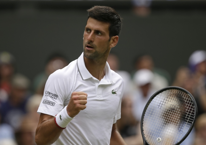 Serbia's Novak Djokovic celebrates winning the second set against Belgium's David Goffin during a men's quarterfinal match on day nine of the Wimbledon Tennis Championships in London, Wednesday, July 10, 2019. (AP Photo/Tim Ireland)