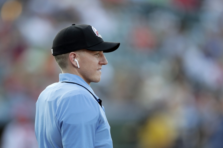 Home plate umpire Brian deBrauwere looks on while wearing an earpiece connected to a ball and strikes calling system prior to the start of the Atlantic League All-Star minor league baseball game, Wednesday, July 10, 2019, in York, Pa. deBrauwere wore the earpiece connected to an iPhone in his ball bag which relayed ball and strike calls upon receiving it from a TrackMan computer system that uses Doppler radar. The independent Atlantic League became the first American professional baseball league to let the computer call balls and strikes during the all star game. (AP Photo/Julio Cortez)