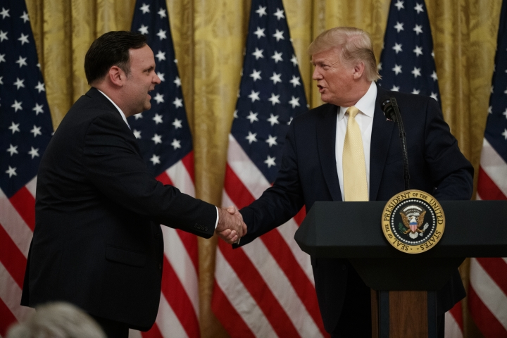 "President Donald Trump shakes hands with White House Social Media Director Dan Scavino during the ""Presidential Social Media Summit"" in the East Room of the White House, Thursday, July 11, 2019, in Washington. (AP Photo/Evan Vucci)"