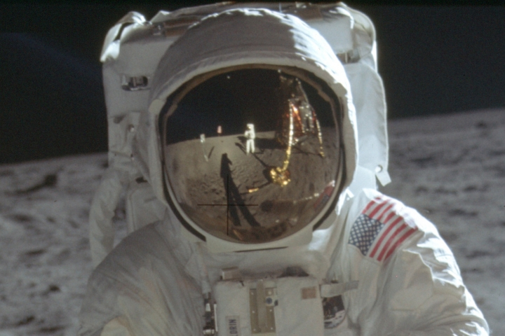 This detail of a July 20, 1969 photo made available by NASA shows astronaut Neil Armstrong reflected in the helmet visor of Buzz Aldrin on the surface of the moon. The astronauts had a camera mounted to the front of their suits, according to the Universities Space Research Association. So rather than holding the camera up to his eye, as we're accustomed to, Armstrong would have taken the photos from near his chest, which is where Armstrong's hands appear to be in his reflection. (Neil Armstrong/NASA via AP)