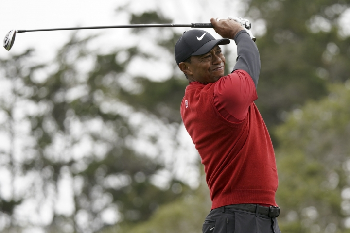 FILE - In this June 16, 2019, file photo Tiger Woods watches his tee shot on the second hole during the final round of the U.S. Open Championship golf tournament in Pebble Beach, Calif. Woods has played just three tournaments, 10 rounds, since he won the Masters. For only the seventh time in his career, he went from one major to the next without having played in between, and then he missed the cut at Bethpage Black in the PGA Championship. (AP Photo/Carolyn Kaster, File)