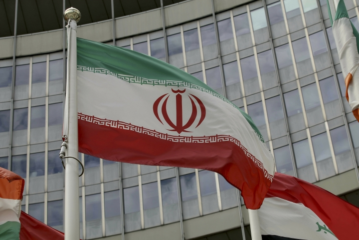 The Iranian flag waves outside of the UN building that hosts the International Atomic Energy Agency, IAEA, office inside in Vienna, Austria, Wednesday, July 10, 2019. (AP Photo/Ronald Zak)