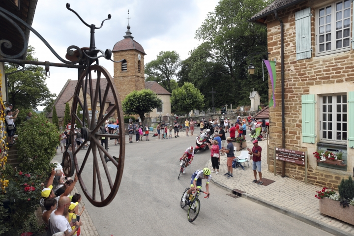 France's Yoann Offredo, center, and France's Stephane Rossetto, ride breakeway during the seventh stage of the Tour de France cycling race over 230 kilometers (142,9 miles) with start in Belfort and finish in Chalon sur Saone, France, Friday, July 12, 2019. (AP Photo/Thibault Camus)
