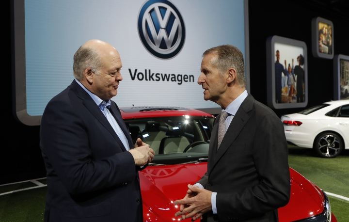 FILE - In this Jan. 14, 2019, file photo Ford Motor Co. President and CEO, Jim Hackett, left, meets with Dr. Herbert Diess, CEO of Volkswagen AG, at the North American International Auto Show in Detroit. Ford and Volkswagen are planning to unveil details about their budding alliance to build mobility services and autonomous and electric vehicles. Executives from both companies are planning to reveal details Friday, July 12. (AP Photo/Carlos Osorio, File)