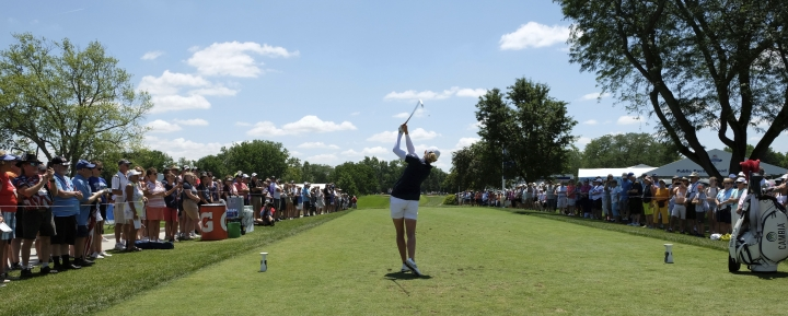 A large gallery watches Toledo, Ohio, native Stacy Lewis, center, tee off on No. 10 in the second round during the LPGA Marathon Classic golf tournament at Highland Meadows Golf Club in Sylvania, Ohio, Friday, July 12, 2019. (Lori King/The Blade via AP)