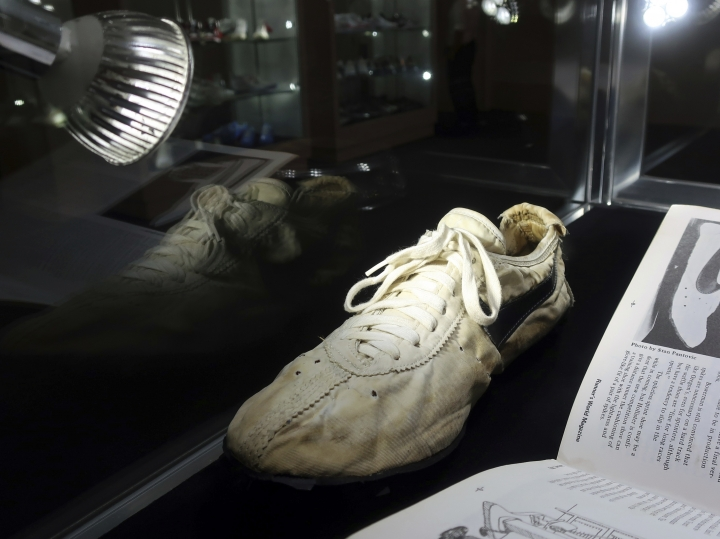 """A Nike """"Moon Shoe"""" is on display at Sotheby's auction house in New York on July 12, 2019. Nike co-founder Bill Bowerman designed the shoe's sole using his wife's waffle iron. The shoes were made for runners at the 1972 Olympic trials. Sotheby's expects the shoes to auction online for between $110,000 to $160,000. (AP Photo/Ted Shaffrey)"""