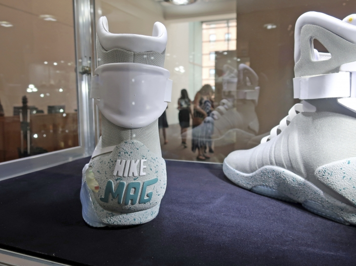 """A pair of 2016 """"Nike Mag Back to the Future"""" shoes are on display at Sotheby's auction house in New York on July 12, 2019. Sotheby's expects the shoes to auction online for $50,000 to $70,000 (AP Photo/Ted Shaffrey)"""