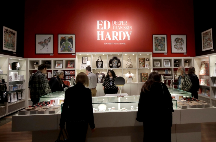 "In this Wednesday, July 10, 2019 photo, visitors look through merchandise for sale during a media preview of ""Ed Hardy: Deeper than Skin"" at the de Young Museum in San Francisco. The exhibition opening Friday, July 12 sheds light on Hardy as a prolific artist and tattoo pioneer. (AP Photo/Jeff Chiu)"
