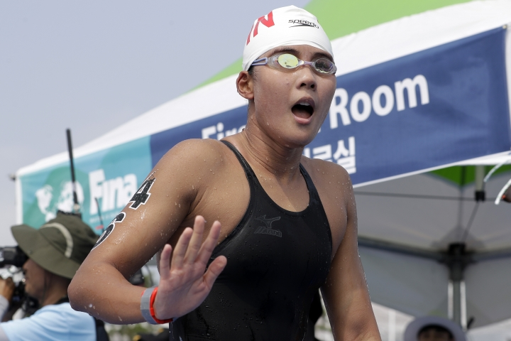 Xin Xin of China reacts after competing in the women's 10km open water swim at the World Swimming Championships in Yeosu, South Korea, Sunday, July 14, 2019. (AP Photo/Mark Schiefelbein)