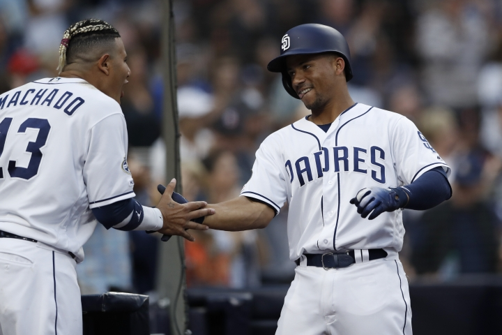 San Diego Padres' Francisco Mejia, right, is greeted by teammate Manny Machado after hitting a home run during the fifth inning of a baseball game against the Atlanta Braves, Saturday, July 13, 2019, in San Diego. (AP Photo/Gregory Bull)