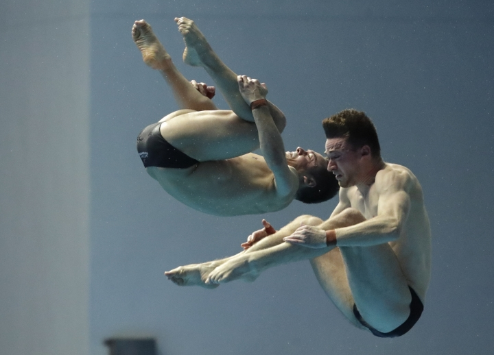 Britain's Thomas Daley and Matthew Lee compete in the men's 10m platform synchro diving final at the World Swimming Championships in Gwangju, South Korea, Monday, July 15, 2019. (AP Photo/Lee Jin-man )