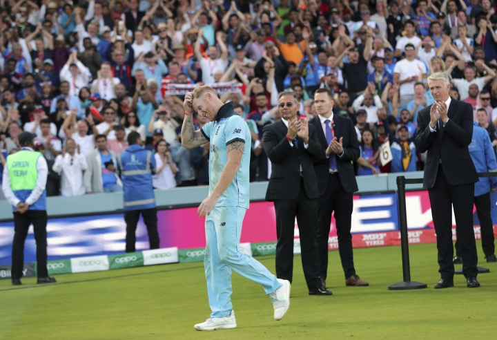 England's Ben Stokes walks to receive the Player of the Match award after his team won the Cricket World Cup final match between England and New Zealand at Lord's cricket ground in London, England, Sunday, July 14, 2019. (AP Photo/Aijaz Rahi)