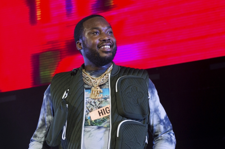 FILE - This June 1, 2019, file photo shows Meek Mill performing at HOT 97 Summer Jam 2019 in East Rutherford, New Jersey. Lawyers for Mill will ask an appeals court Tuesday, July 16, 2019, to overturn a 2008 drug and gun conviction that's kept the Philadelphia rapper on probation for a decade. They say the city judge who oversees the case and sent him to prison in 2017 on a parole violation has a grudge against the performer. (Photo by Scott Roth/Invision/AP, File)