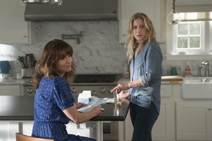 """This image released by Netflix shows Linda Cardellini, left, and Christina Applegate in a scene from """"Dead To Me."""" On Tuesday, July 16, 2019, Applegate was nominated for an Emmy Award for outstanding actress in a comedy series. (Saeed Adyani/Netflix via AP)"""