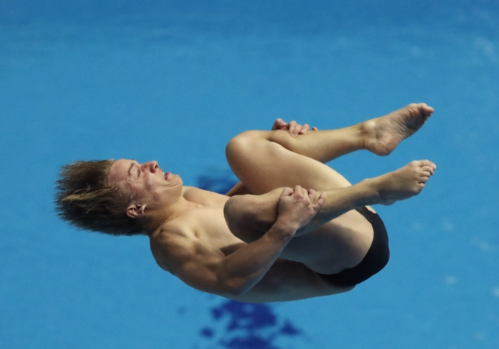 Australia's Cassiel Rousseau performs in the mixed team event diving final at the World Swimming Championships in Gwangju, South Korea, Tuesday, July 16, 2019. (AP Photo/Lee Jin-man )
