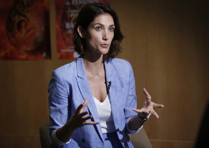 In this March 16, 2019, photo, Cindy Bishop speaks during an interview with the Associated Press in Bangkok, Thailand. Bishop launched the Don't Tell Me How To Dress campaign, after her viral social media post about women being told to cover up to avoid sexual assault. The #MeToo movement in entertainment isn't just an American phenomenon. Cases across Asia show the region is grappling with many of the same issues that have upended entertainment careers in the U.S. (AP Photo/Sakchai Lalit)