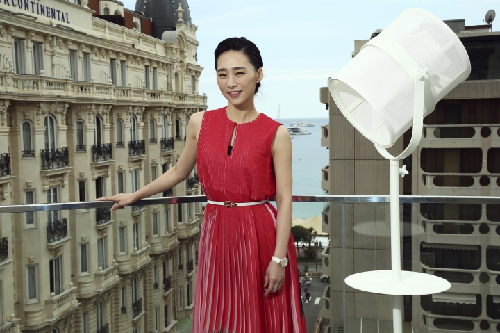 In this May 21, 2019, photo, actress Wu Ke-xi poses for portrait photographs at the 72nd international film festival, Cannes, southern France. Wu Ke-xi wrote a screenplay inspired by the scandal involving U.S. producer Harvey Weinstein. The #MeToo movement in entertainment isn't just an American phenomenon. Cases across Asia show the region is grappling with many of the same issues that have upended entertainment careers in the U.S.(Photo by Joel C Ryan/Invision/AP)