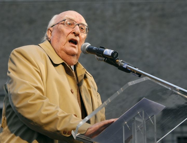 FILE - In this Feb. 21, 2009 file photo, Italian author Andrea Camilleri makes his point during a demonstration against the Vatican's influence on the ongoing right-to-die debate, in Rome. Italian writer Andrea Camilleri, known for his popular novels and TV series centered on the much-loved inspector Salvo Montalbano, died in Rome Wednesday, July 17, 2019 at age 93. Camilleri was Italy's most successful writer, but until he was nearly 70 he had been a virtually unknown author of a handful of historical novels set in his native Sicily. (AP Photo/Alessandra Tarantino, file)