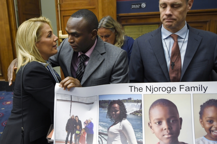 Sara Nelson, left, President of the Association of Flight Attendants, hugs Paul Njoroge, center, before the start of a House Transportation subcommittee hearing on Capitol Hill in Washington, Wednesday, July 17, 2019, on aviation safety as Michael Stumo, right, helps to hold a poster. Njoroge lost his wife and three young children on Ethiopian Airlines Flight 302 and Stumo lost his daughter on the same flight. The plane was a Boeing 737 MAX. (AP Photo/Susan Walsh)