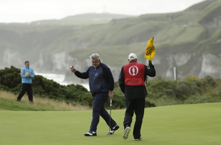 Northern Ireland's Darren Clarke acknowledges the crowd after getting a birdie on the 5th green during the first round of the British Open Golf Championships at Royal Portrush in Northern Ireland, Thursday, July 18, 2019.(AP Photo/Matt Dunham)