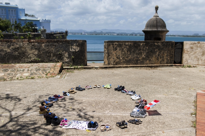 Shoes representing people who died during Hurricane Maria and its aftermath sit in a circle after being placed by protesters in La Rogativa Plaza in San Juan, Puerto Rico, Thursday, July 18, 2019. Protesters are demanding Gov. Ricardo Rossello to resign after the leak of online chats that show him making misogynistic slurs and mocking his constituents. (AP Photo/Dennis M. Rivera Pichardo)