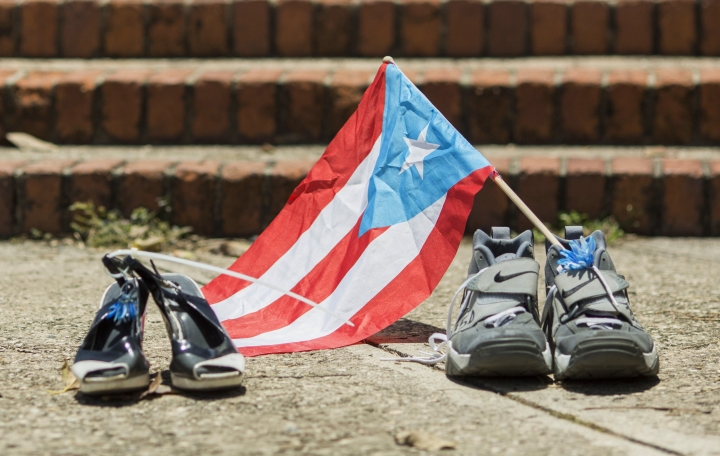 Shoes representing two people who died during Hurricane Maria and its aftermath, one with a Puerto Rican flag in it, sit amid a circle of shoes that were placed there by protesters in La Rogativa Plaza in San Juan, Puerto Rico, Thursday, July 18, 2019. The shoes were first laid out on the steps of the U.S. territory's capitol last year as a protest against government refusal to acknowledge the premature deaths of thousands of people due to the damage wrought by the September 2017 storm. On Thursday, less than 12 hours after the island's largest public protest in years, the shoes became part of a far-flung effort to forge a sustainable protest movement to turn Gov. Ricardo Rosselló out of office. (AP Photo/Dennis M. Rivera Pichardo)