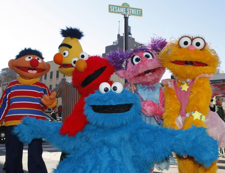 FILE - In this Feb. 10, 2010 file photo, characters from Sesame Street Live appear on the street by Madison Square Garden to celebrate the 30th anniversary of the live touring stage shows based on the PBS television series in New York. From left are Ernie, Bert, Elmo, Cookie Monster (foreground), Abby Cadabby, and Zoe. Iconic actress Sally Field and foundational children's show Sesame Street top this year's class of Kennedy Center Honors recipients. Other chosen to receive the award for lifetime achievement in the arts include singer Linda Ronstadt, conductor Michael Tilson Thomas and the R&B group Earth, Wind and Fire. (AP Photo/Kathy Willens, File)