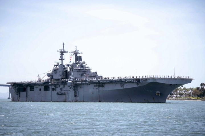 "In this May 1, 2019, photo provided by the U.S. Navy, the amphibious assault ship USS Boxer (LHD 4) transits the San Diego Bay in San Diego, Calif. President Donald Trump says the USS Boxer destroyed an Iranian drone in the Strait of Hormuz amid heightened tensions between the two countries. Trump says it's the latest ""hostile"" action by Iran. (Mass Communication Specialist 2nd Class Jesse Monford/U.S. Navy via AP)"