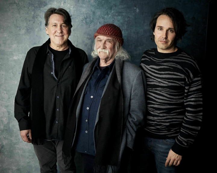 "FILE - In this Jan. 26, 2019 photo, producer Cameron Crowe, from left, David Crosby and director A.J. Eaton pose for a portrait to promote the film ""David Crosby: Remember My Name"" at the Salesforce Music Lodge during the Sundance Film Festival in Park City, Utah. Crosby has turned down repeated offers to do a biopic, but said yes to doing a documentary with Crowe's involvement that examines his turbulent life. The film opens in limited release on Friday, July 19, 2019, and includes the rocker's candid reflections on his career, relationships and feuds. (Photo by Taylor Jewell/Invision/AP, File)"