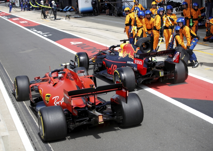 Ferrari driver Charles Leclerc of Monac, left, tries to overtake Red Bull driver Max Verstappen of the Netherland's after a pit service, during the British Formula One Grand Prix at the Silverstone racetrack, Silverstone, England, Sunday, July 14, 2019. (Photo Matthew Childs/Reuters Pool Via AP)