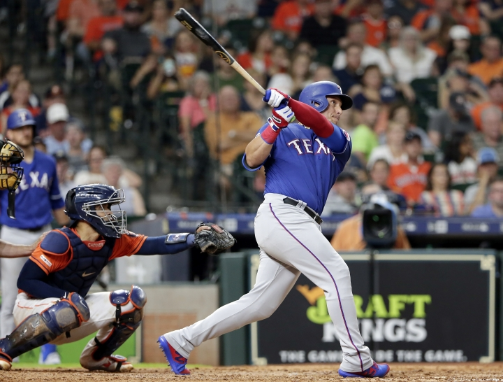 Texas Rangers' Asdrubal Cabrera, right, watches his home run in front of Houston Astros catcher Robinson Chirinos during the sixth inning of a baseball game Friday, July 19, 2019, in Houston. (AP Photo/Michael Wyke)