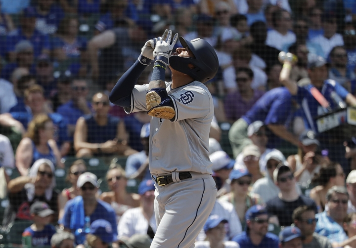 San Diego Padres' Manny Machado celebrates after hitting a two-run home run during the third inning of a baseball game against the Chicago Cubs in Chicago, Saturday, July 20, 2019. (AP Photo/Nam Y. Huh)