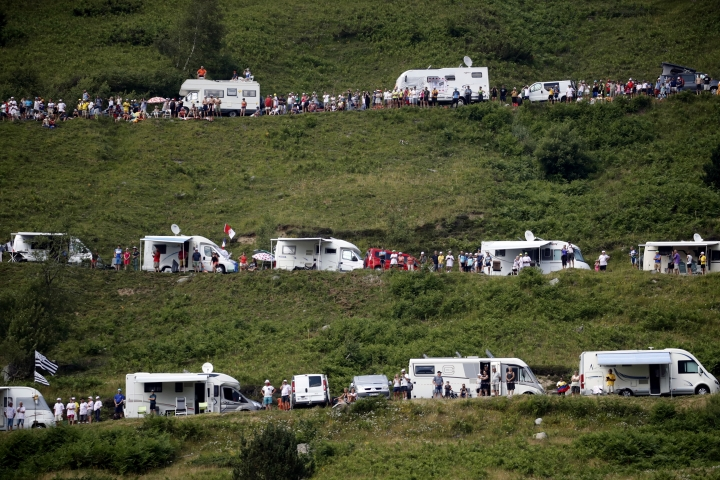 Camping cars of spectators are parked along the road of the Tourmalet pass during the fourteenth stage of the Tour de France cycling race over 117.5 kilometers (73 miles) with start in Tarbes and finish at the Tourmalet pass, France, Saturday, July 20, 2019. (AP Photo/ Christophe Ena)