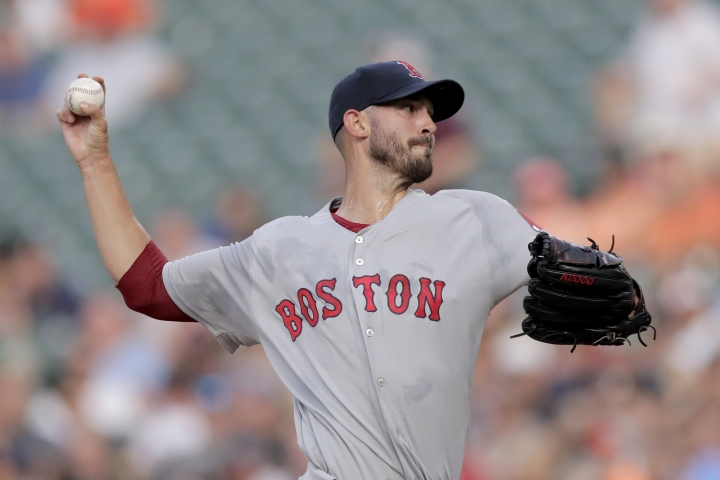 Boston Red Sox starting pitcher Rick Porcello throws to a Baltimore Orioles batter during the first inning of a baseball game, Saturday, July 20, 2019, in Baltimore. (AP Photo/Julio Cortez)
