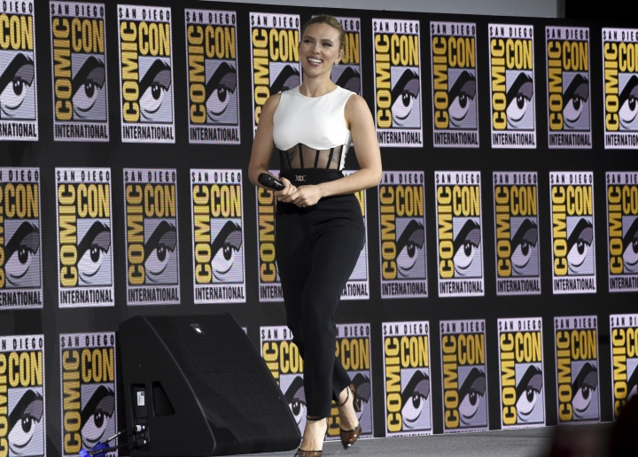"""Scarlett Johansson walks on stage during the """"Black Widow"""" portion of the Marvel Studios panel on day three of Comic-Con International on Saturday, July 20, 2019, in San Diego. (Photo by Chris Pizzello/Invision/AP)"""