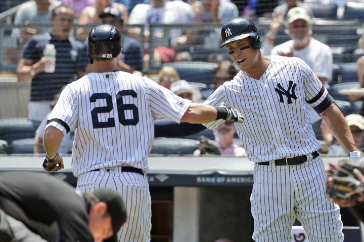 New York Yankees' Aaron Judge, right, celebrates with DJ LeMahieu (26) after LeMahieu hit a solo home run during the first inning of a baseball game against the Colorado Rockies at Yankee Stadium, Sunday, July 21, 2019, in New York. (AP Photo/Seth Wenig)