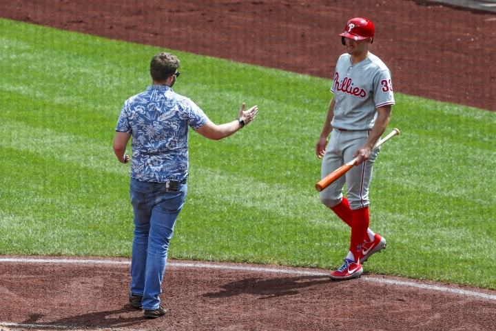 Philadelphia Phillies' Brad Miller, right, backs away as a man walks towards him as he comes to bat in the sixth inning of a baseball game against the Pittsburgh Pirates, Sunday, July 21, 2019, in Pittsburgh. The police took the man from the field and play continued. (AP Photo/Keith Srakocic)