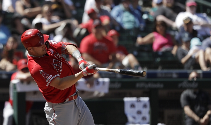 Los Angeles Angels' Mike Trout connects for a solo home run against the Seattle Mariners in the seventh inning of a baseball game Sunday, July 21, 2019, in Seattle. (AP Photo/Elaine Thompson)