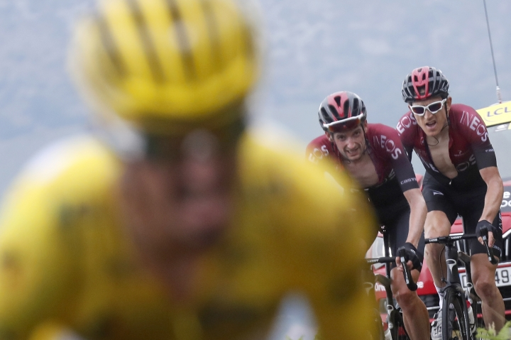 Netherlands' Wout Poels, center, Britain's Geraint Thomas, right, and France's Julian Alaphilippe wearing the overall leader's yellow jersey climb Prat d'Albis during the fifteenth stage of the Tour de France cycling race over 185 kilometers (114,95 miles) with start in Limoux and finish in Prat d'Albis, France, Sunday, July 21, 2019. (AP Photo/Thibault Camus)
