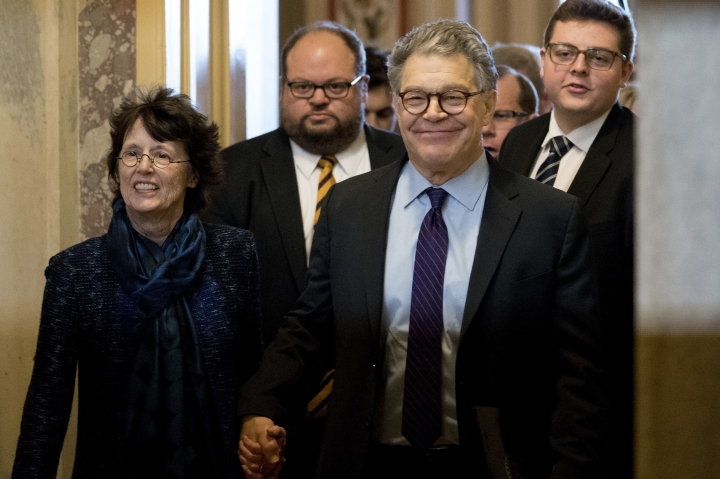 "FILE - In this Dec. 7, 2017, file photo, Sen. Al Franken, D-Minn., second from right, holds hands with his wife Franni Bryson, left, as he leaves the Capitol after speaking on the Senate floor on Capitol Hill in Washington. Franken says he ""absolutely"" regrets resigning from the Senate after eight women accused him of unwanted kissing or touching. Franken made the comments in an article published by the New Yorker magazine on Monday, July 22, 2019. (AP Photo/Andrew Harnik, File)"