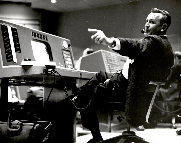 In this undated photo provided by NASA, Christopher Kraft, flight director during Project Mercury, works at his console inside the Flight Control area at Mercury Mission Control, in Houston. Kraft, the founder of NASA's mission control, died Monday, July 22, 2019, just two days after the 50th anniversary of the Apollo 11 moon landing. He was 95. (NASA via AP)