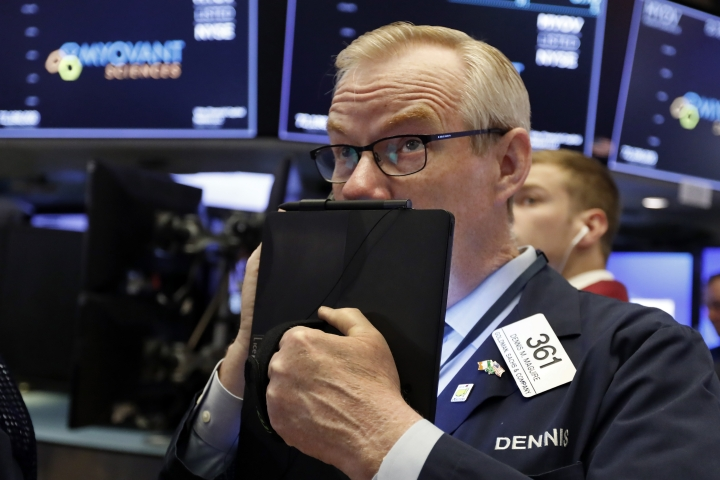 FILE - In this Thursday, July 18, 2019, file photo trader Dennis Maguire works on the floor of the New York Stock Exchange. The U.S. stock market opens at 9:30 a.m. EDT on Tuesday, July 23. (AP Photo/Richard Drew, File)