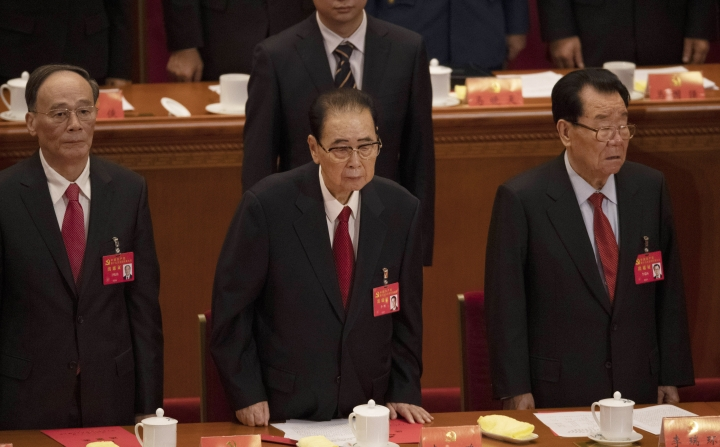 CORRECTS AGE TO 90, INSTEAD OF 91 - In this Oct. 24, 2017, photo, former Chinese Premier Li Peng, center, attends the closing session of China's 19th Party Congress at the Great Hall of the People in Beijing, China. Li Peng, a former hard-line Chinese premier best known for announcing martial law during the 1989 Tiananmen Square pro-democracy protests, has died on Monday July 22, 2019 of unspecified illness. He was 90. (AP Photo/Ng Han Guan)