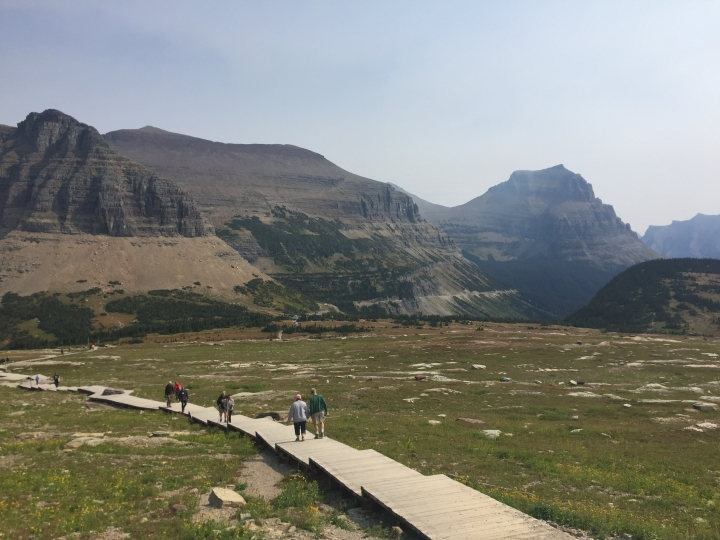 File - This Sept. 4, 2017, file photo, shows hikers on the Hidden Lake trail in Glacier National Park in Montana. Wildlife officials are asking people who are traveling near Glacier National Park to report sightings of animals crossing the road. The Missoulian reported Monday, July 22, 2019, that park officials and the U.S. Geological Survey want to know where animals are crossing U.S. Highway 2. (AP Photo/Beth J. Harpaz, File)