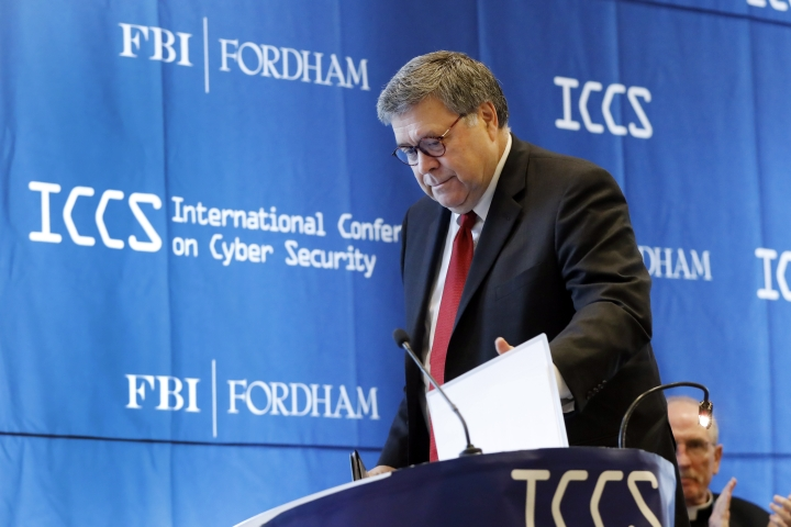 U.S. Attorney General William Barr approaches the podium to address the International Conference on Cyber Security, hosted by the FBI and Fordham University, at Fordham University in New York, Tuesday, July 23, 2019. (AP Photo/Richard Drew)