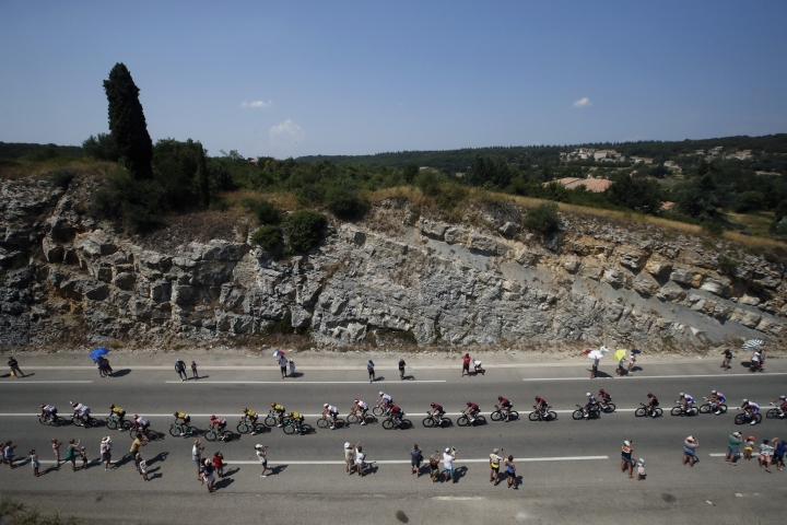 The pack rides during the sixteenth stage of the Tour de France cycling race over 117 kilometers (73 miles) with start and finish in Nimes, France, Tuesday, July 23, 2019. (AP Photo/ Christophe Ena)