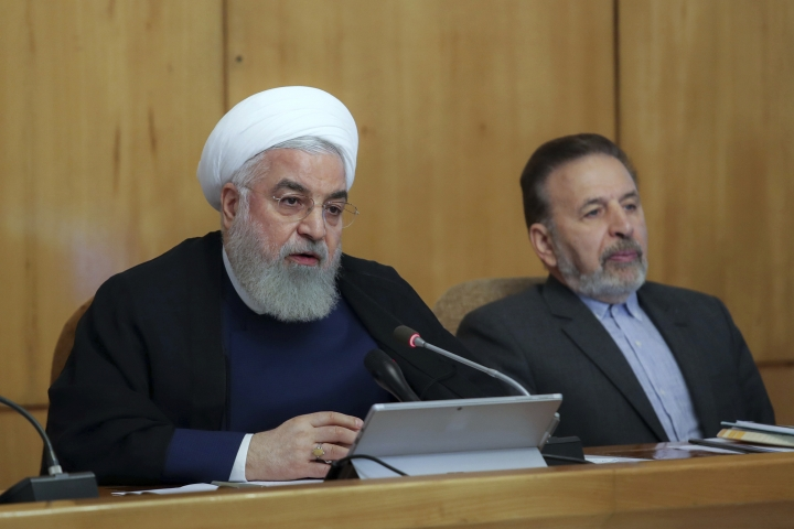 In this photo released by the office of the Iranian Presidency, President Hassan Rouhani speaks in a cabinet meeting in Tehran, Iran, Wednesday, July 24, 2019. President Hassan Rouhani suggested on Wednesday that Iran might release a U.K.-flagged ship if Britain takes similar steps to release an Iranian oil tanker seized by the British Royal Navy off Gibraltar earlier this month. (Iranian Presidency Office via AP)
