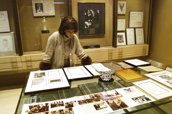 FILE - In this Dec. 10, 2001 file photo Linda Johnson Rice, president and chief operating officer of Jet magazine, looks over awards and recognitions won by the magazine in its 50-year lifetime at Jet's Chicago headquarters. The sale of the photo archive of Ebony and Jet magazines chronicling African American history is generating relief among some who worried the historic images may be lost. But it's also causing some to mourn the fact that the prints won't fully be in the hands of an African American-owned entity. (AP Photo/Ted S. Warren, File)